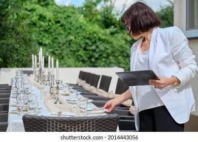 Organization of weddings, parties, catering for events. Female on the background banquet decorated table, table setting decoration