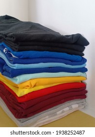 Organized clothes in the closet according to color