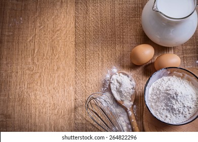 organized copyspace flour in bowl and spoon egss pitcher with milk on wooden board food and drink still life