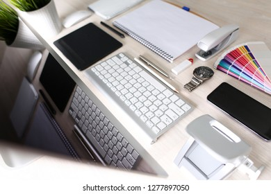 Organized designer workplace at office desk closeup. Different items arranged ordered and ready to use concept