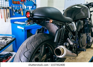 Organized motorcycle workshop with motorbike ready to be customized