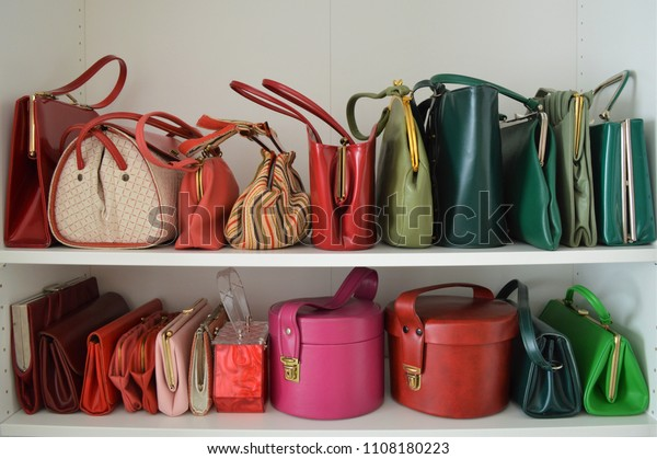 Organized red and green vintage handbag collection