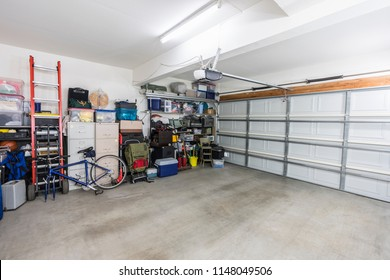 Organized suburban residential garage with shelves, file cabinets, tools and sports equipment.