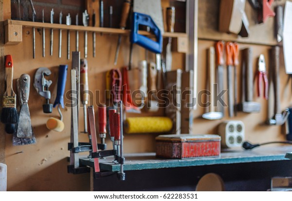 Organized wall of tools and electricity plug