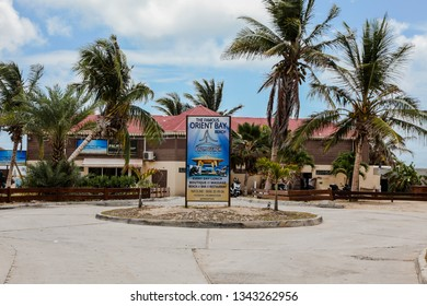 ORIENT BAY BEACH, ST.MAARTEN/ ST.MARTIN -  AUGUST 02, 2015:  Entrance and sign for famous Orient Bay Beach.