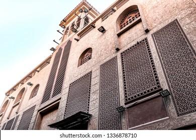 Oriental architecture with traditional Arabic patterns on the windows. Heritage Village, Deira, Dubai, Jan.2017
