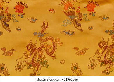Oriental background with embroidered ornament.