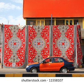 oriental carpet hangs in the streets of the Egyptian town