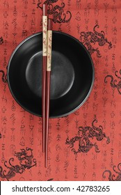 Oriental ceramic bowl and chopsticks on traditional auspicious  background.