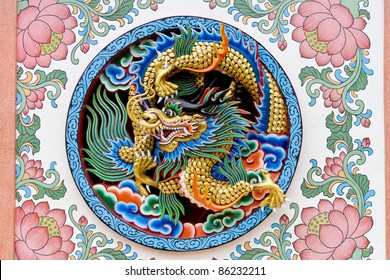 Oriental design of an ancient Chinese dragon on a temple wall in Thailand