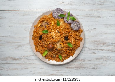 Oriental dish of rice with chicken. Kabsa with chicken.