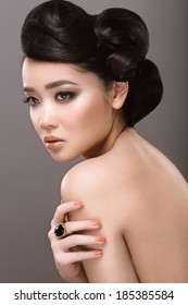 Oriental girl with evening hairstyle