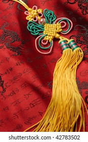 Oriental handicraft,Traditional lucky knot on Jin-Silk background.lucky Chinese knot pray the safety and property for the owner.