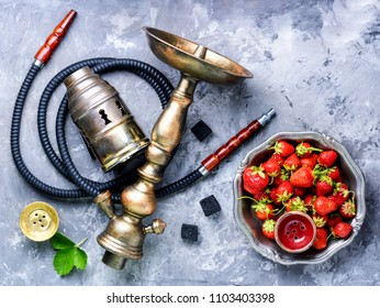 Oriental hookah with the aroma strawberry for relax.Strawberry shisha