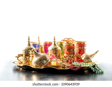 Oriental hospitality. Arabic tea coffee table with golden cups. Ramadan kareem