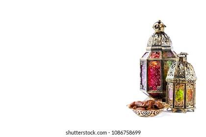 Oriental light lantern decoration and sweet food. Arabic holidays banner. Ramadan kareem. Eid mubarak