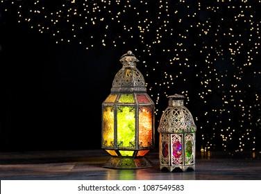 Oriental light lantern. Holidays decoration on black background. Eid mubarak. Ramadan kareem
