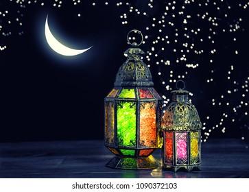 Oriental light lantern with moon and stars. Ramadan kareem. Vintage style toned picture