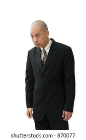 Oriental man in business suit with head hung down looking sad