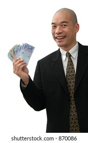 Oriental man in business suit holding up money