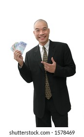 Oriental man in suit holding up a handful of cash bills.