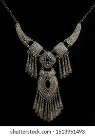 Oriental necklace on black background in low key, Silver jewellery. Indian, Arab, African, Egyptian. Fashion Exotic Asian Accessories. Tribal Jewellery for belly dance oriental costumes. Dark