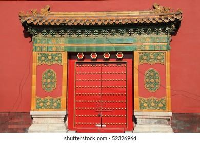 oriental red gate inside Beijing Forbidden City, China