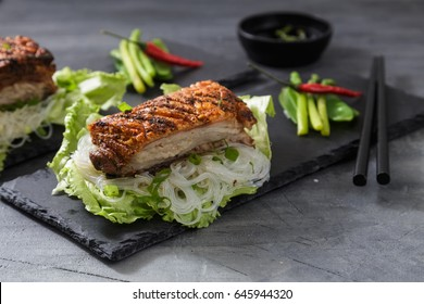Oriental Roast Pork Belly with crispy skin with greens and noodles