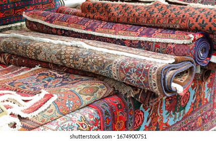 oriental rugs for sale in the market stall on the street