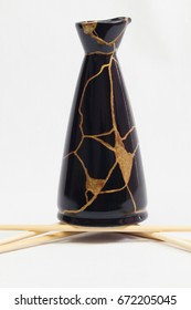 An oriental sake bottle that was broken and I repaired it using the Japanese art form of kintsugi.
