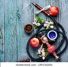 Oriental smoking hookah. Arabian shisha with apple. Hookah with apple.Fruit smoking hookah