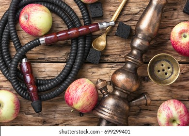 Oriental smoking hookah with the aroma of autumn apples