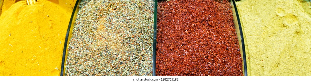 Oriental spices in Grand Bazaar, Istanbul, Turkey. This bazaar is a famous landmark of Istanbul. Colorful flavouring food in the eastern bazar. Horizontal banner with detail of the market counter.