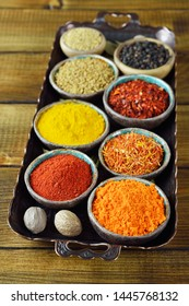 Oriental spices and seasonings on brown background