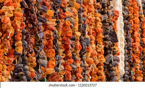 Oriental spices sun dried eggplants paprika peppers and vegetables hanging up at Turkish grocery market