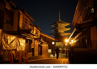Oriental streets in Kyoto at night,background is a famous tower