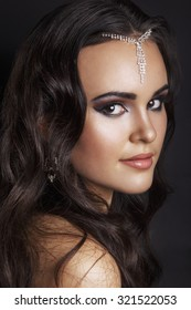 Oriental style. Sensual arabic woman model. Beautiful clean skin, saturated makeup. Bright eye make-up and dark eyeliner.Arab woman. Beautiful creative makeup.