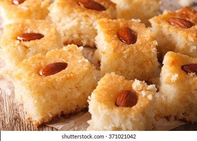 Oriental sweets: basbousa with almonds on a table close-up. horizontal