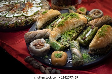 Oriental sweets and confectionery in Ottoman traditions from Turkey. Turkish delights and sweet desserts - various types of arabic baklava with pistachios and lokum with nuts.