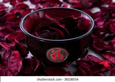 oriental tea cup filled with red petals