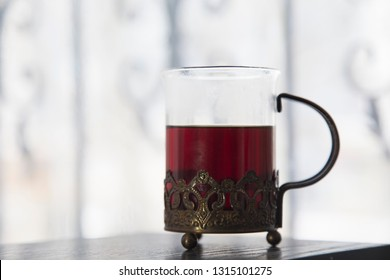 Oriental traditional a holder for glass of tea. It is located in a blurred background.
