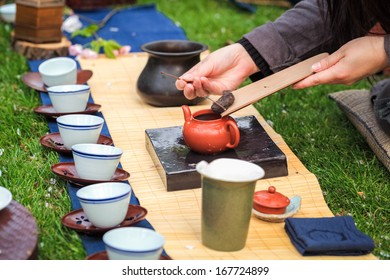 oriental traditional tea ceremony on the grass