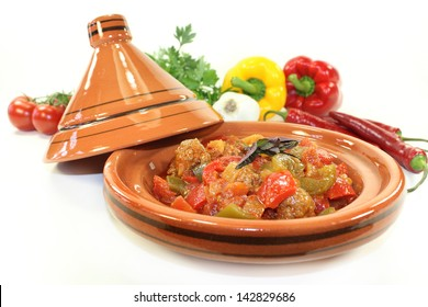 oriental vegetables pan with peppers, tomato and meatballs