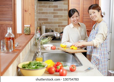 Oriental woman to cook