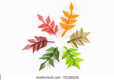 origami autumn rowan leaves on white background