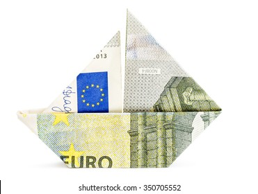 Origami boat made of 5 euro bill isolated on white background.