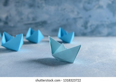 Origami boats on color table