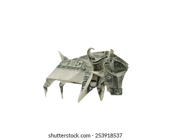 An origami bull made of a dollar bill.  This may represent bull market in capitalist economy.