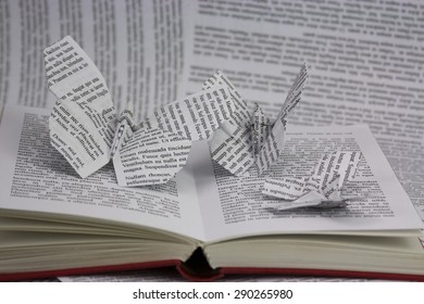 Origami butterflies with words coming out of a book. Lorem Ipsum text used.