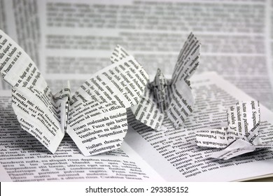 Origami butterflies with words coming out of a book. Lorem Ipsum test used. PROPERTY RELEASE ATTACHED TO SAY THAT  THE TEXT DOES NOT COME UNDER COPYRIGHT BUT WAS CREATED BY ME USING LOREM IPSUM
